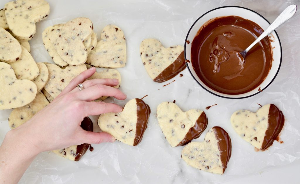 Butter Cookies with Mini Chocolate Chips - Simple recipe comes together in minutes. Cut into hearts and dip in chocolate for Valentine's Day. So cute and delicious! Makes a great teachers gift too!