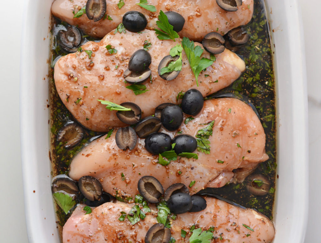 Make chicken exciting! Artichoke hearts, olives and a rich marinade will take your chicken to new levels!