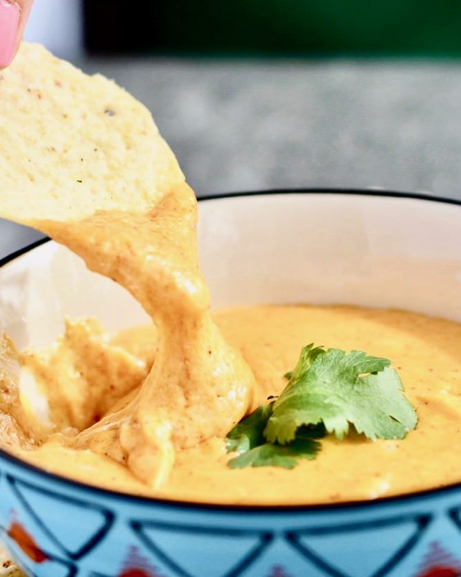 Easy Queso Dip ready in minutes! Amazing flavor goes great with nachos, topping for enchiladas or any dish!