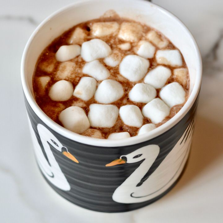 Hygge Hot Chocolate made with almond coconut milk. Curl up and keep warm with Hygge cocoa.