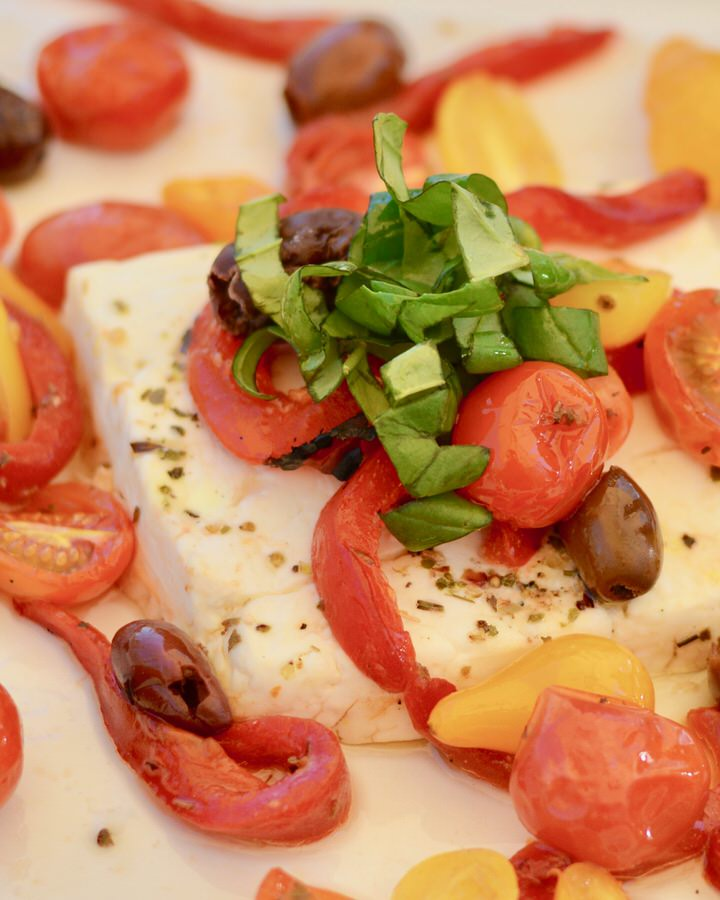 Baked Feta with Tomatoes, Olives, Red Pepper and Basil, Herbs and Olive Oil. Serve with homemade baked pita chips!