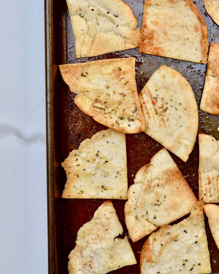 Healthier homemade baked pita chips. Olive oil, italian seasoning and salt. Simple and easy!
