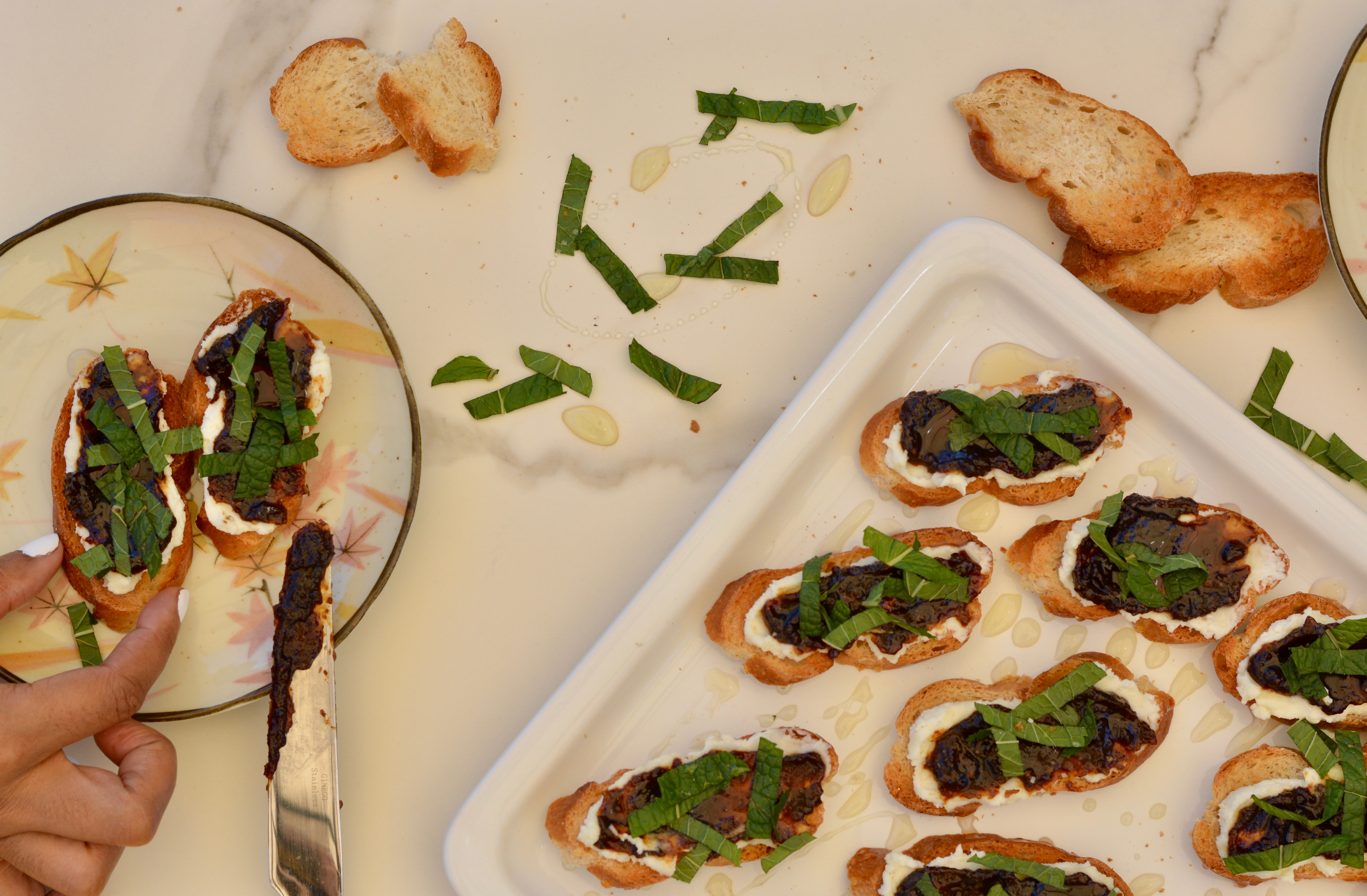 Goat Cheese Crostini Appetizer with Honey, Fig Jam and Fresh Mint.