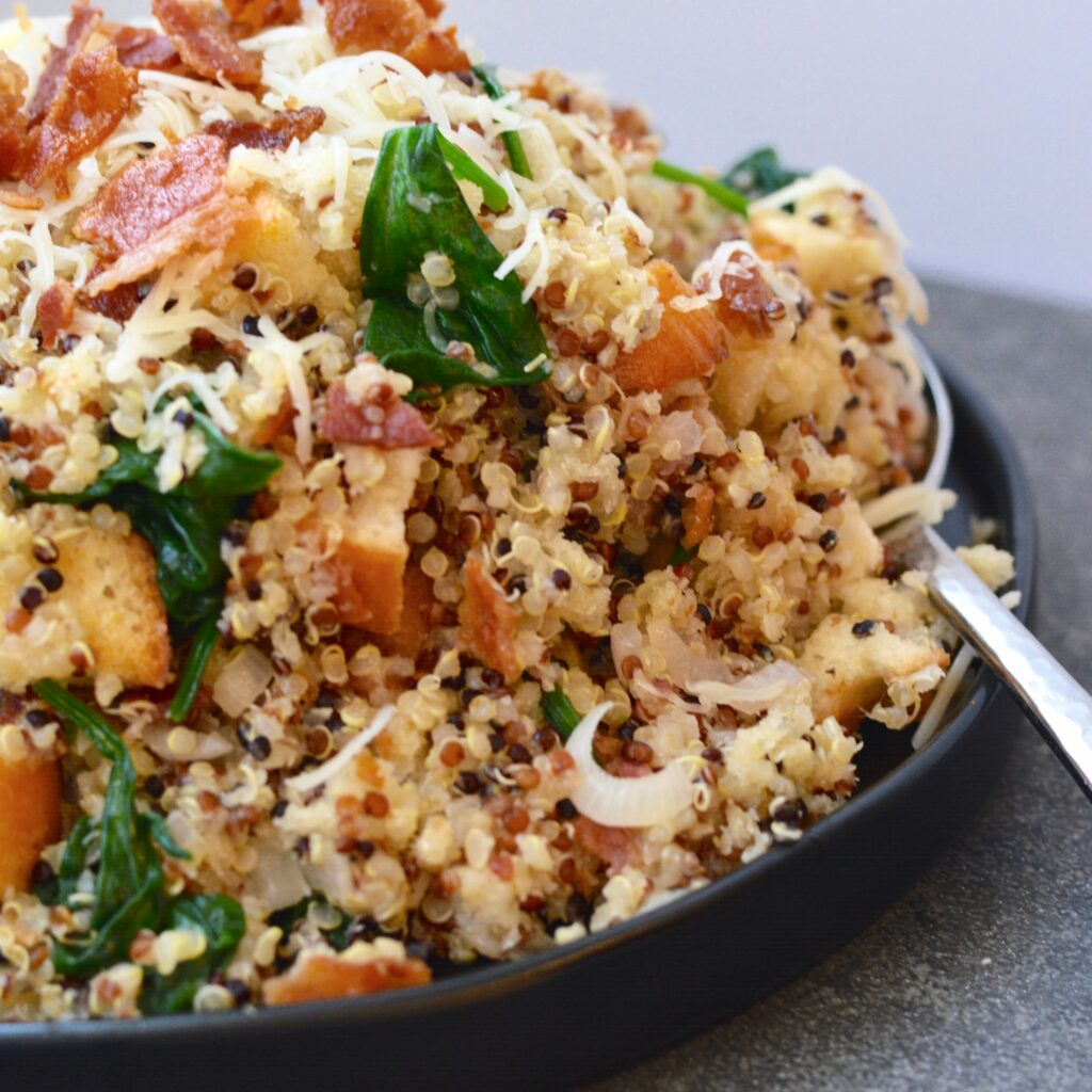 Quinoa spinach bacon and breadcrumb side dish warm and healthy