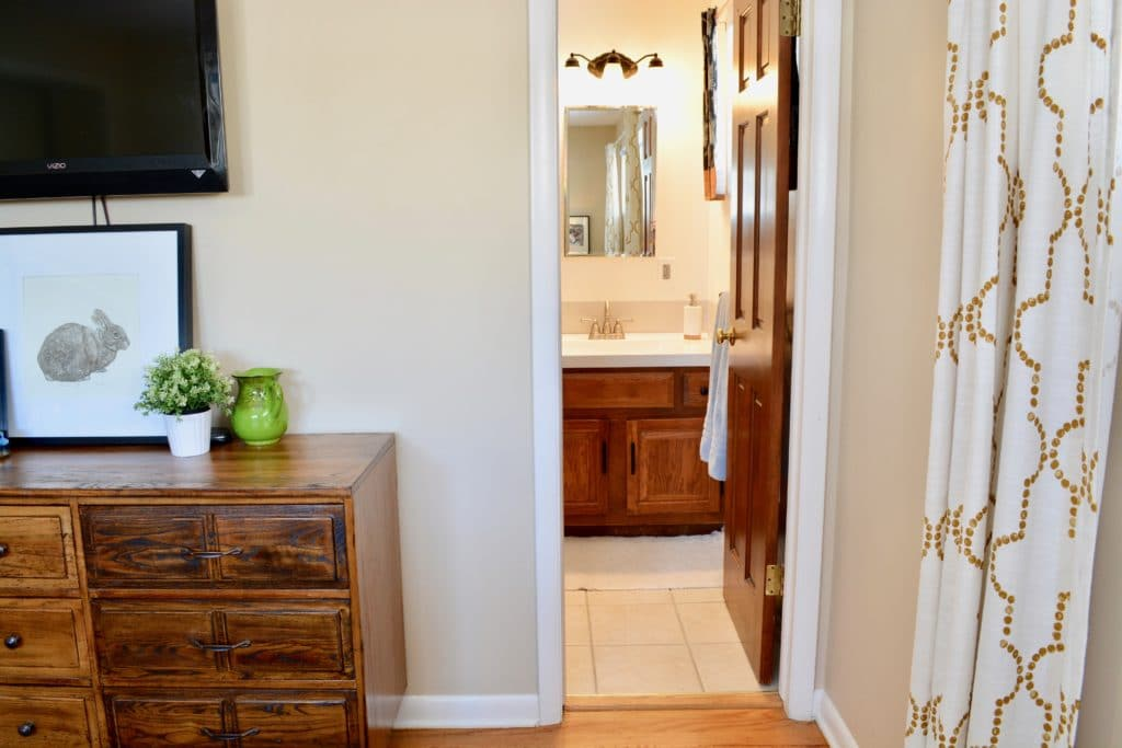 Airbnb rental ideas and how to rent your home. Master bedroom en suite photograph.