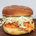 Buffalo Chicken and Blue Cheese Slaw Burger - pulled chicken with homemade blue cheese dressing. Seriously delicious and so simple! Great to make ahead.