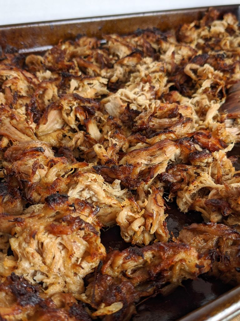 Carnitas made so full of flavor and so simple to make in a slow cooker or crock pot. Coca cola, orange juice, onion and spices flavor our pork shoulder or butt. YUM!