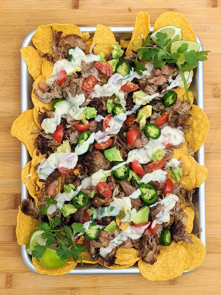 Simple Carnitas Nachos perfect for Sunday night dinner. LOVE each delicious topping: Jalapeño Pinto Beans, Easy Carnitas and Monterey Jack Queso!
