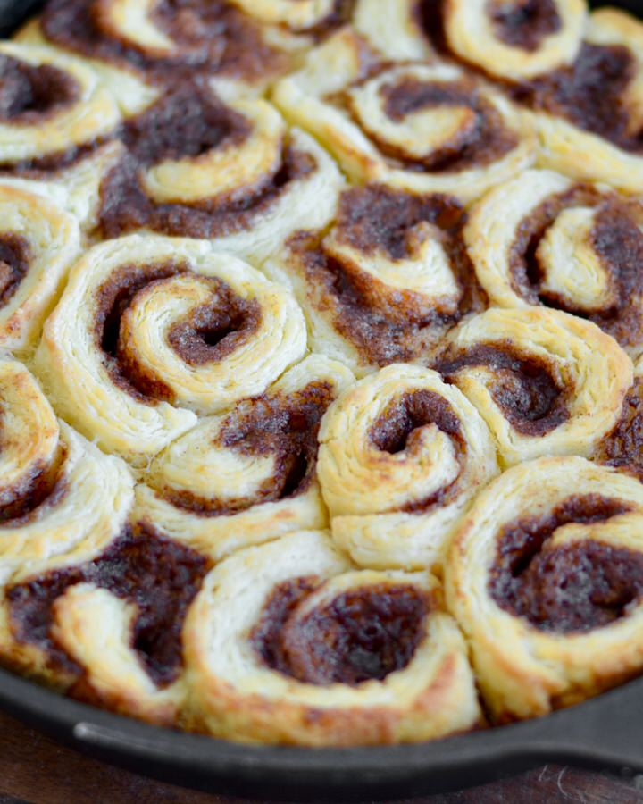 Mini Biscuit Cinnamon Rolls | Super quick recipe with no rise time. Perfectly flaky, full of cinnamon and sugar and covered in icing perfection!