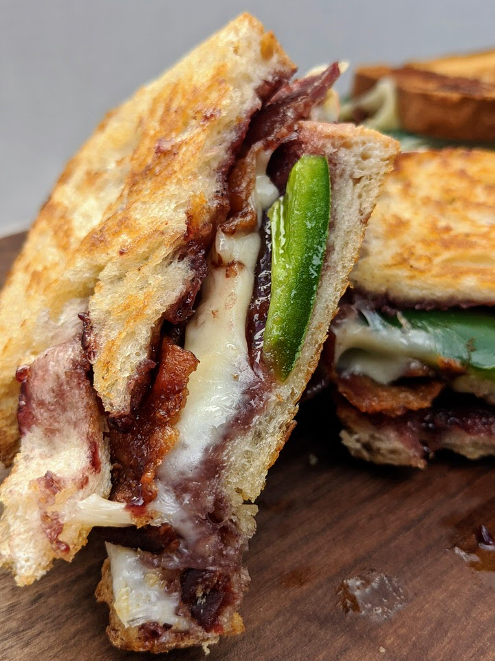 Jalapeño Blackberry Bacon Grilled Cheese | Mix up your grilled cheese night with this amazing flavor combination! Blackberry jam, jalapeño, bacon and your favorite cheese all on toasted sourdough bread. YUM!