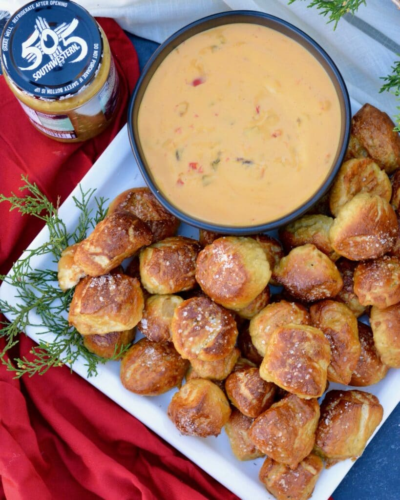 Pretzel Bites with a Kick! Adding fresh 505 Southwestern salsa right in the dough makes these pretzel bites really special. Dip in queso for the ultimate snack. #505southwestern #salsa #pretzels