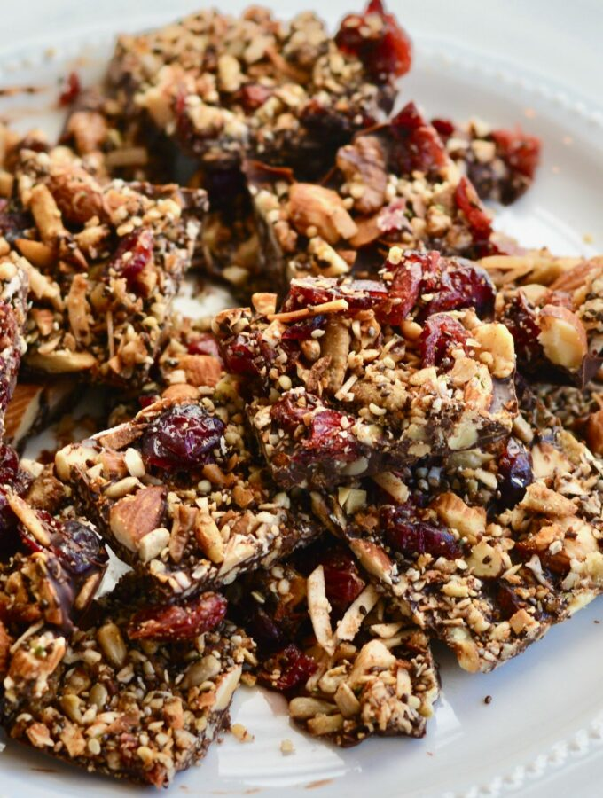 Grain Free Granola and Cranberry Chocolate Bark | Perfect Holiday Snack or Gift. Dark chocolate topped with lightly sweetened grain free granola and dried cranberries. Delicious!