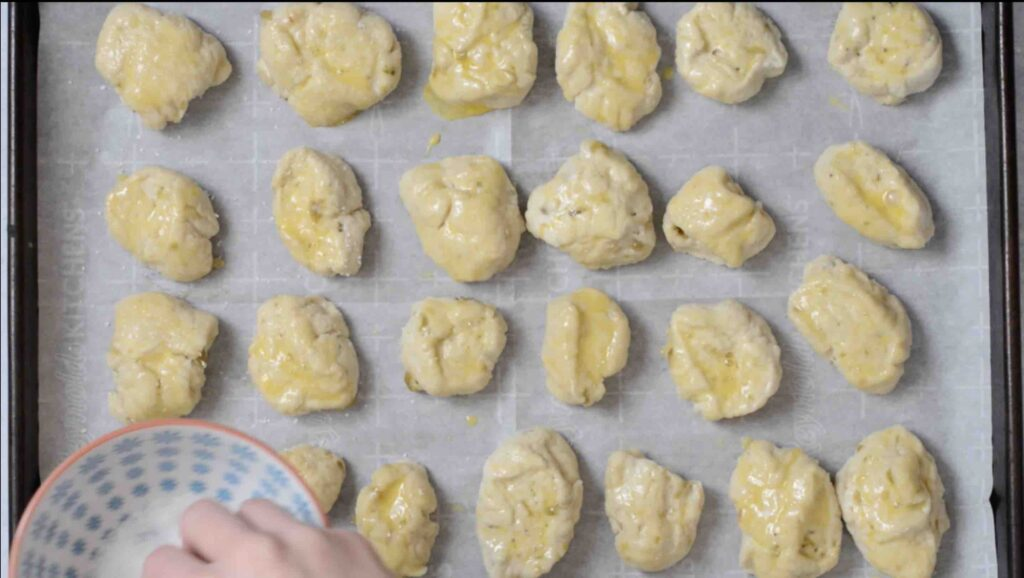 Step 11 - Pretzel Bites with a Kick! Adding fresh 505 Southwestern salsa right in the dough makes these pretzel bites really special. Dip in queso for the ultimate snack. #505southwestern #salsa #pretzels