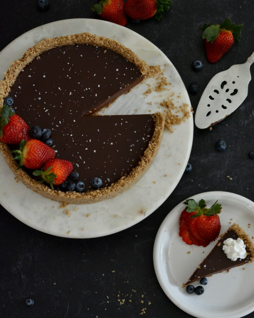 Gluten Free Dairy Free Chocolate Ganache Tart | Completely simple and delicious no-bake tart. Crust made with pecans and oats, filling made with dark chocolate and cream coconut milk. Feels indulgent without the guilt.