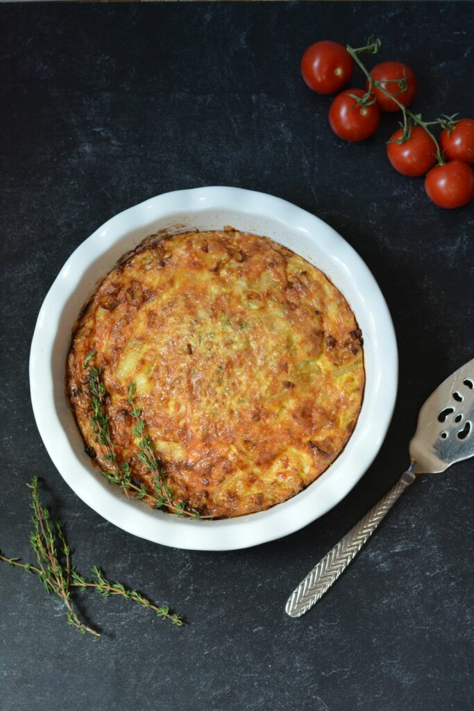 Onion and Gruyere Crustless Quiche | Simple ingredients for a deliciously rich and creamy quiche. Top it off with arugula and sour cream. Totally amazing!