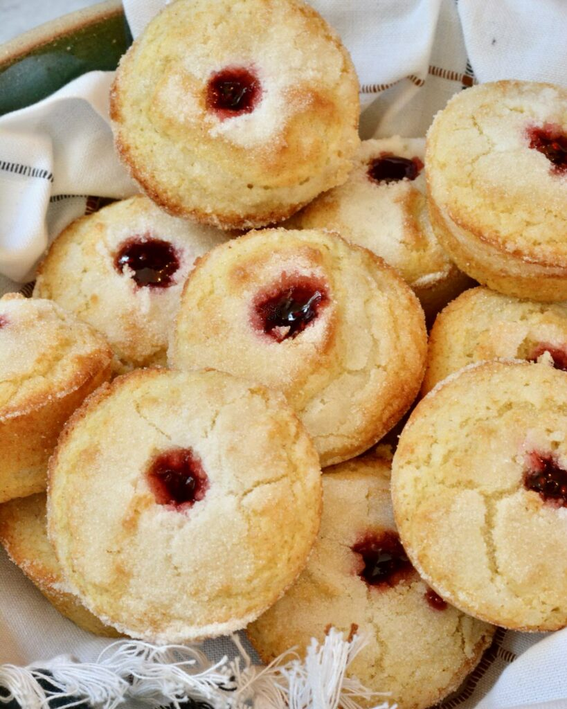 Sweet Donut Muffins made gluten free in this simple one bowl recipe. Why have just a muffin, when you can have a donut muffin? Filled with raspberry jam and relaxing moments. Perfect grab and go breakfast the whole family will treasure.