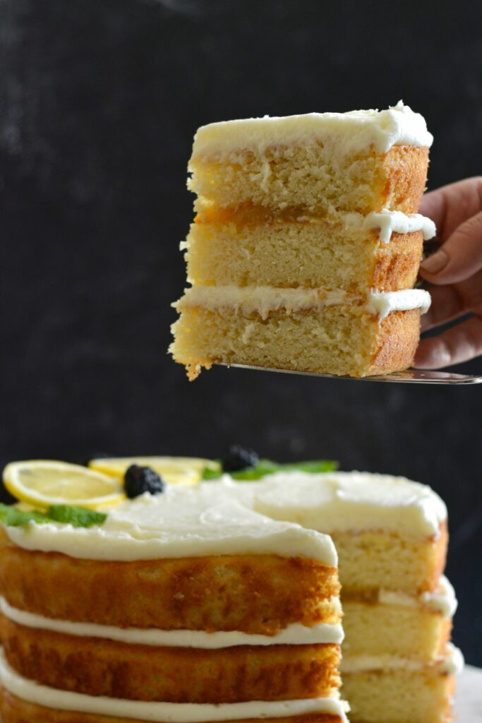Gluten Free Lemon Layer Cake for the win! The perfect summer dessert. So festive and beautiful. The perfectly light, fluffy cake, layered with lemon buttercream and lemon curd. Add blackberries or any summer fruit for a delightful summer flavor.